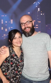 man with beard standing next to woman