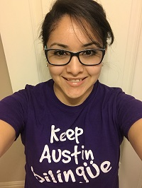 "woman with brown hair and glasses wearing a shirt that says ""Keep Austin Bilingual"""
