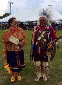 woman and man in traditional indigenous clothing